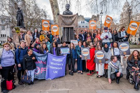 Stock Picture of Jess Phillips MP, Labour Party MP for Birmingham Yardley, and Maria Miller MP, Conservative MP for Basingstoke, and Chair of the Women and Equalities Committee (WEC), join other supporters gather at the memorial to Millicent Fawcett in Parliament Square