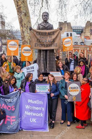 Stock Image of Jess Phillips MP, Labour Party MP for Birmingham Yardley, and Maria Miller MP, Conservative MP for Basingstoke, and Chair of the Women and Equalities Committee (WEC), join other supporters gather at the memorial to Millicent Fawcett in Parliament Square