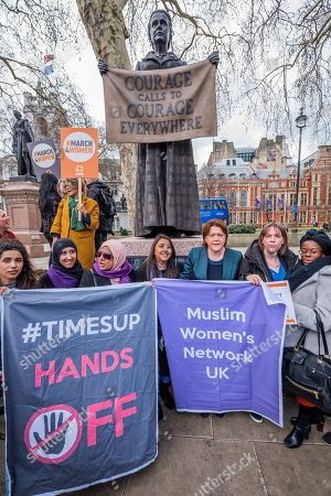 Jess Phillips MP, Labour Party MP for Birmingham Yardley, and Maria Miller MP, Conservative MP for Basingstoke, and Chair of the Women and Equalities Committee (WEC), join other supporters gather at the memorial to Millicent Fawcett in Parliament Square
