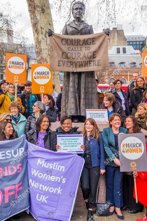 Stock Photo of Jess Phillips MP, Labour Party MP for Birmingham Yardley, and Maria Miller MP, Conservative MP for Basingstoke, and Chair of the Women and Equalities Committee (WEC), join other supporters gather at the memorial to Millicent Fawcett in Parliament Square