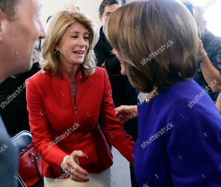 Stock Picture of Wendy Davis, Nancy Pelosi. Former state senator Wendy Davis, center, visits with Speaker of the House Nancy Pelosi, D-Calif., right, following a stop for a news conference, in Austin, Texas