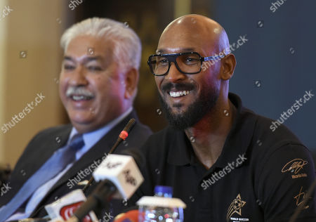 Former French soccer player Nicolas Anelka  (R) talks with journalists after he arrived to promote soccer in the country in Islamabad, Pakistan, 05 May 2019.