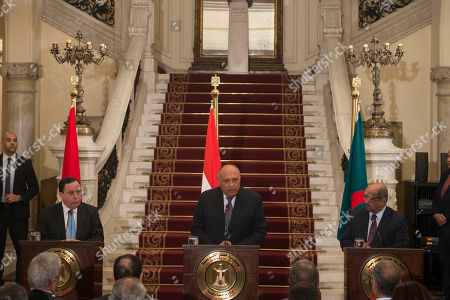 Stock Photo of Egyptian foreign minister Sameh Shoukry (C) and his counterparts Algerian Abdelkader Messahel (R) and Tunisian Khemaies Jhinaoui (L) hold a press conference to discuss Libya at Al Tahrir Palace in Cairo, Egypt, in 05 March 2019.