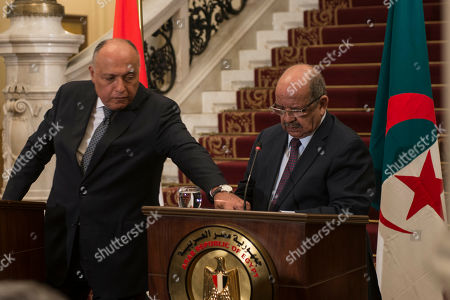 Algerian Abdelkader Messahel (R) speaks during a press conference with his counterparts Egyptian Sameh Shoukry (L) and Tunisian Khemaies Jhinaoui to discuss Libya at Al Tahrir Palace in Cairo, Egypt, in 05 March 2019.