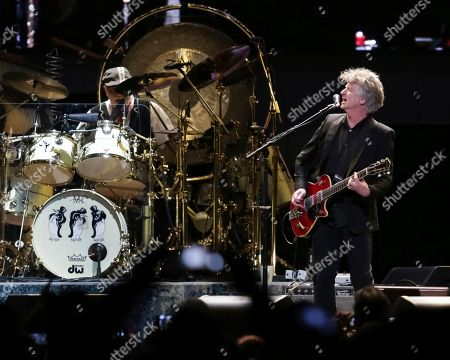 Mick Fleetwood, Neil Finn. Drummer Mick Fleetwood, left, and vocalist/guitarist Neil Finn perform onstage with Fleetwood Mac at the Capital One Arena, in Washington