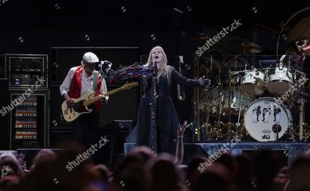 John McVie, Stevie Nicks. Bassist John McVie, left, and singer/songwriter Stevie Nicks perform onstage with Fleetwood Mac at the Capital One Arena, in Washington