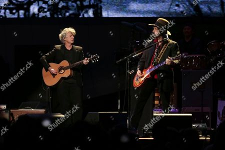 Neil Finn, Mike Campbell. Vocalist/guitarist Neil Finn left, and guitarist Mike Campbell perform onstage with Fleetwood Mac at the Capital One Arena, in Washington