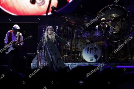 John McVie, Stevie Nicks, Mick Fleetwood. Bassist John McVie, from left, singer/songwriter Stevie Nicks and drummer Mick Fleetwood perform onstage with Fleetwood Mac at the Capital One Arena, in Washington