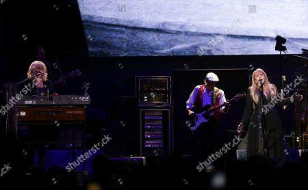 Christine McVie, John McVie, Stevie Nicks. Singer/keyboardist Christine McVie, from left, bassist John McVie and singer/songwriter Stevie Nicks perform onstage with Fleetwood Mac at the Capital One Arena, in Washington