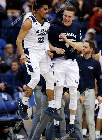 Stock Photo of David Cunningham, Jazz Johnson. Nevada guard Jazz Johnson, left, celebrates his basket with guard David Cunningham during the second half of an NCAA college basketball game against Air Force, at Air Force Academy, Colo. Nevada won 90-79