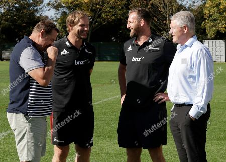 New Zealand All Blacks captain Kieran Read, second right, stands with All Blacks coach Steve Hansen, left, Crusaders coach Scott Robertson and New Zealand Rugby Chief Executive Steve New, right, talk following a press conference in Christchurch, New Zealand, . Read confirmed that 2019 will be his swansong year in New Zealand Rugby after which the 33-year-old will join Japanese club Toyota Verblitz next year