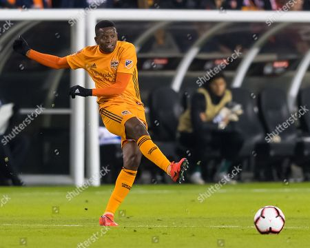 Houston Dynamo midfielder Oscar Garcia (27) sends the ball during the CONCACAF Champions League quarter finals game 18 leg 1 between UANL Tigres and Houston Dynamo at BBVA Compass Stadium in Houston, Texas UANL Tigres beat Houston Dynamo 2-0. ©Maria Lysaker/CSM