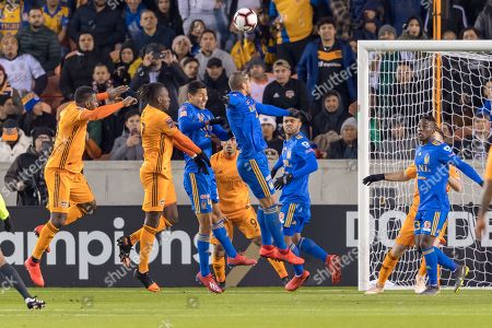 UANL Tigres defender Hugo Ayala (4) and Houston Dynamo forward Alberth Elis (17) during the CONCACAF Champions League quarter finals game 18 leg 1 between UANL Tigres and Houston Dynamo at BBVA Compass Stadium in Houston, Texas The score at the half 0-0 ©Maria Lysaker/CSM