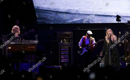 Christine McVie, John McVie, Stevie Nicks. Singer/keyboardist Christine McVie, from left, bassist John McVie and singer/songwriter Stevie Nicks perform on stage with Fleetwood Mac at the Capital One Arena, in Washington