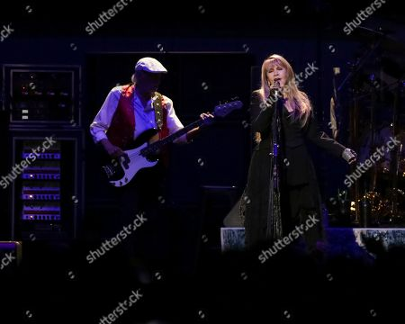 John McVie, Stevie Nicks. Bassist John McVie, left, and singer/songwriter Stevie Nicks perform on stage with Fleetwood Mac at the Capital One Arena, in Washington
