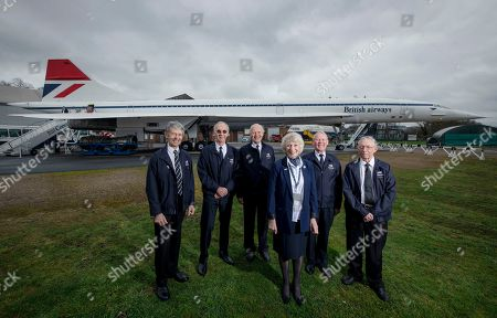 Stock Photo of The Golden Jubilee of the maiden flight of Concorde, from Toulouse, on the 2nd March 1969.  Former Concorde pilots gather around 'Delta Golf'  (the first Concorde to carry 100 passengers at Mach 2.) at Brooklands, Weybridge. Ian Smith, pilot, Tony Heald, pilot, Brian Oliver, pilot Carol Cornwell, Cabin Crew, Ian Smith, Flight Engineer and Viv Gunton, pilot, Captain Mike Bannister, Chief Pilot and Carol Cornwell, Cabin Crew