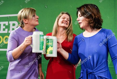 Stock Image of (L-R) Bavarian Alliance 90/The Greens party fraction leader Katharina Schulze, Bavarian top candidate for the European elections Henrike Hahn and Greens party co-leader Annalena Baerbock attend the Political Ash Wednesday gathering of the Greens Party in Landshut, Germany, 06 March 2019. All major German political parties traditionally hold rallies on Ash Wednesday where rhethoric is usually heated and closely watched by the media.