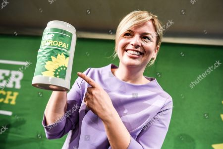 Stock Picture of Bavarian Alliance 90/The Greens party fraction leader Katharina Schulze holds beer mug at the Political Ash Wednesday gathering of the Greens Party in Landshut, Germany, 06 March 2019. All major German political parties traditionally hold rallies on Ash Wednesday where rhethoric is usually heated and closely watched by the media.