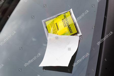 Stock Photo of A parking ticket seen on Stoke City footballer, Saido Berahino's car left outside Highbury Corner Magistrates court.