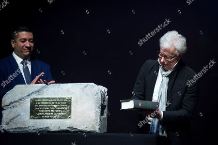 Welsh writer Ken Follet (R) puts a copy of his novel 'The Pillars of the Earth' inside the foundation stone of the musical 'The Cathedral of Dreams', based on his famous book, next to the composer Ivan Macias (L) during a press conference to present the show in Madrid, Spain, 06 March 2019. The world premiere of the musical will be held in Madrid at the end of 2020.