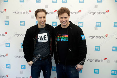 WE Day founders Canadian brothers Craig, left, and Marc Kielburger pose for photographers as they arrive to attend WE Day UK, a global initiative to encourage young people to take part in positive social change at the SSE Arena in Wembley, London