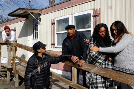 Brandon Jackson, Antone Black, Kym Lofland, LaToya Holley, Monique Sorrell. Brandon Jackson, from far left, Kym Lofland, Antone Black, Monique Sorrell and LaToya Holley stand on a ramp where a struggle among their family member Anton Black and three police officers and a civilian occurred before his death outside the home in Greensboro, Md. The family isn't satisfied by the conclusions of a county prosecutor, who isn't pursuing criminal charges in Black's death, or the medical examiner who ruled it accidental. They're calling for a federal investigation and appealing for help from Gov. Larry Hogan, who already has expressed a personal interest in the case