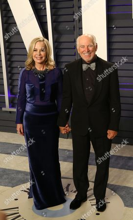 Jimmy Buffett (R) and Jane Slagsvol (L) pose at the 2019 Vanity Fair Oscar Party following the 91st annual Academy Awards ceremony, in Beverly Hills, California, USA, 24 February 2019. The Oscars are presented for outstanding individual or collective efforts in 24 categories in filmmaking. The Oscars are presented for outstanding individual or collective efforts in 24 categories in filmmaking.