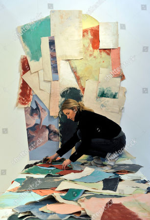Stock Picture of Emerging artist Scarlett Bowman adding the finishing touches to her installation at Affordable Art Fair Battersea Spring, as part of Platform Projects