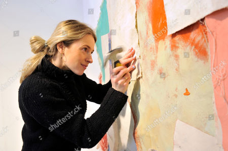 Emerging artist Scarlett Bowman adding the finishing touches to her installation at Affordable Art Fair Battersea Spring, as part of Platform Projects