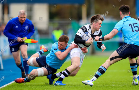 Stock Picture of Belvedere College vs St. Michael's College. Belvedere's Simon Murphy with Will Hickey of St. Michael's