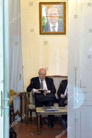 British Minister of State for the Middle East and North Africa Alistair Burt reads in a notebook as he waits in the Foreign Ministry office before a meeting with Lebanese Foreign Minister Gibran Bassil in Beirut, Lebanon, 06 March 2019. Burt is on a two-day official visit to meet with Lebanese officials. He is the first British diplomat to visit Lebanon after Britain declared that Hezbollah is a terrorist organization.