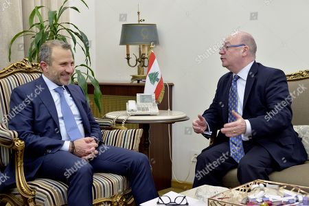 Stock Image of Lebanese Foreign Minister Gibran Bassil (L) meets with British Minister of State for the Middle East and North Africa Alistair Burt (R) at the Foreign Ministry in Beirut, Lebanon, 06 March 2019. Burt is on a two-day official visit to meet with Lebanese officials. He is the first British diplomat to visit Lebanon after Britain declared that Hezbollah is a terrorist organization.