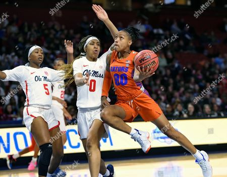 Florida's Delicia Washington right, drives to the basket while defended by Mississippi's Gabby Crawford, center, and Crystal Allen during the second half of a women's Southeastern conference NCAA basketball tournament game, in Greenville, S.C