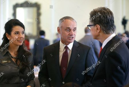 Stock Photo of Linda Henry, Rob Manfred, John Henry. Major League Baseball Commissioner Rob Manfred, center, speaks with Boston Red Sox owner John Henry, right, and Boston Globe Managing Director Linda Henry, left, at a gathering of the Boston College Chief Executives Club, in Boston