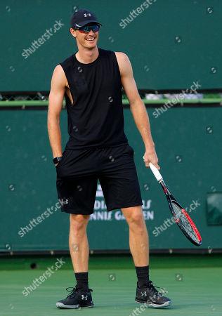 Jamie Murray of Great Britain laughs during practice