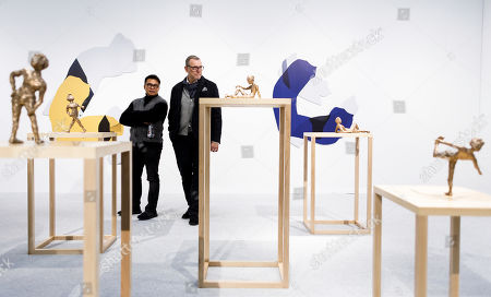 Stock Picture of Two men look at sculptures by Ivan Argote at The Armory Show, an annual art fair, in New York, New York, USA, 06 March 2019. The show features 20th- and 21st-century art presented by galleries from around the world.