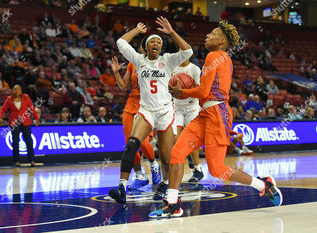 Stock Picture of Kiara Smith, Crystal Allen. Florida's Kiara Smith, right, drives against Mississippi's Crystal Allen during the first half of an women's Southeastern conference NCAA basketball tournament game, in Greenville, S.C