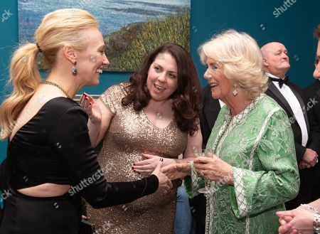 Camilla Duchess of Cornwall meets Victoria Smurfit during the reception of the dinner to mark St Patrick's Day and celebrate UK-Irish relations at the Embassy of Ireland