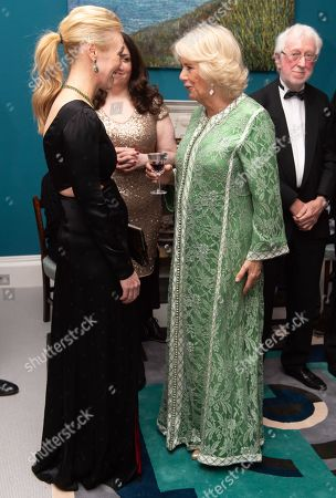 Stock Photo of Camilla Duchess of Cornwall meets Victoria Smurfit during the reception of the dinner to mark St Patrick's Day and celebrate UK-Irish relations at the Embassy of Ireland