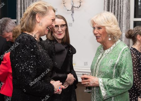 Camilla Duchess of Cornwall meets Orla Kiely (C) during the reception of the dinner to mark St Patrick's Day and celebrate UK-Irish relations at the Embassy of Ireland