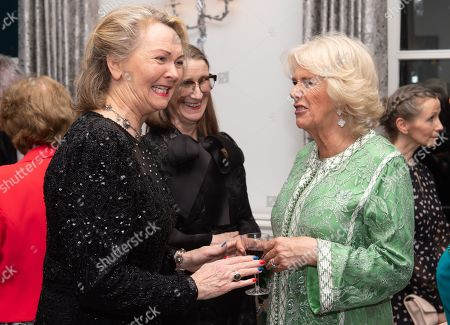 Stock Photo of Camilla Duchess of Cornwall meets Orla Kiely (C) during the reception of the dinner to mark St Patrick's Day and celebrate UK-Irish relations at the Embassy of Ireland