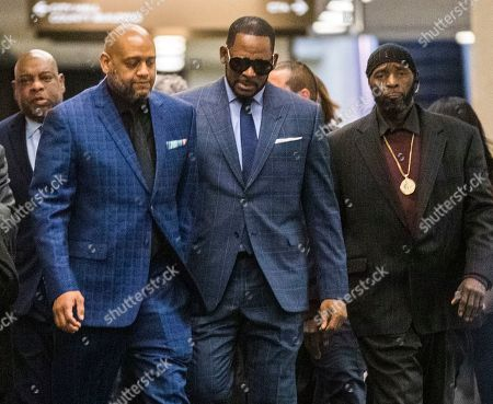 US R& B singer R. Kelly (2R) arrives for a child support hearing at the Cook County Circuit Court at the Daley Center in Chicago, Illinois, USA 06 March 2019. Kelly, who faces criminal sexual abuse charges, has failed to pay more than 161,000 USD in back child support. He was taken into custody to be returned to the Cook County Jail after failing to pay the full amount he owes.