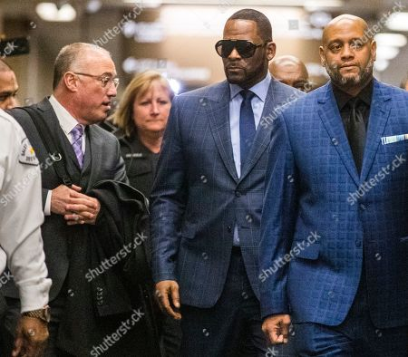 US R& B singer R. Kelly (2R) arrives with attorney Steve Greenberg (L) for a child support hearing at the Cook County Circuit Court at the Daley Center in Chicago, Illinois, USA 06 March 2019. Kelly, who faces criminal sexual abuse charges, has failed to pay more than 161,000 USD in back child support. He was taken into custody to be returned to the Cook County Jail after failing to pay the full amount he owes.