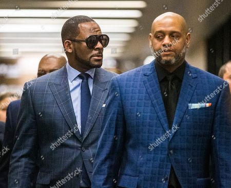 US R& B singer R. Kelly (L) arrives for a child support hearing at the Cook County Circuit Court at the Daley Center in Chicago, Illinois, USA, 06 March 2019. Kelly, who faces criminal sexual abuse charges, has failed to pay more than 161,000 USD in back child support. He was taken into custody to be returned to the Cook County Jail after failing to pay the full amount he owes.