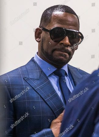 US R& B singer R. Kelly arrives for a child support hearing at the Cook County Circuit Court at the Daley Center in Chicago, Illinois, USA 06 March 2019. Kelly, who faces criminal sexual abuse charges, has failed to pay more than 161,000 USD in back child support. He was taken into custody to be returned to the Cook County Jail after failing to pay the full amount he owes.