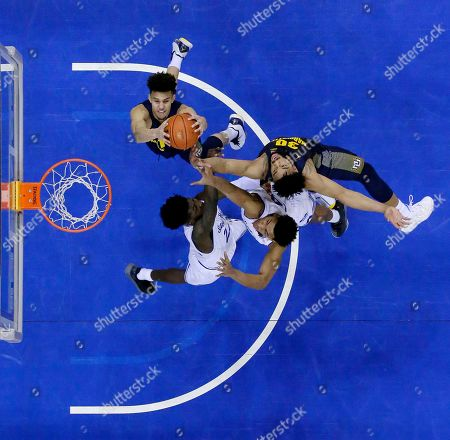 Stock Photo of Marquette forward Brendan Bailey, top left, and teammate forward Ed Morrow, top right, go up for a defensive rebound against Seton Hall guard Myles Cale, left, and guard Jared Rhoden during the second half of an NCAA college basketball game, in Newark, N.J. Seton Hall won 73-64