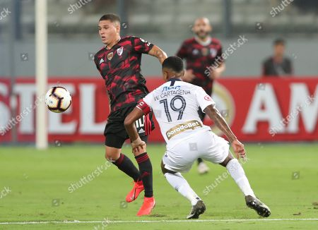 Stock Image of Alianza Lima's Wilder Cartagena (R) vies for the ball with River Plate's Juan Fernando Quintero (L) during their Copa Libertadores group A soccer match between Alianza Lima and River Plate at Nacional stadium in Lima, Peru, 06 March 2019.