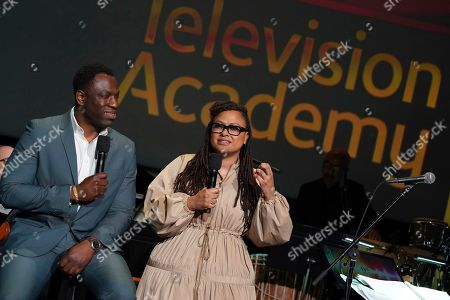 """Stock Image of Hans Charles, Ava DuVernay. Cinematographer Hans Charles, left, and producer/director Ava DuVernay discuss their music choices for the Emmy winning """"13th"""" at the Television Academy member event """"Perfect Harmony: A Live Performance Celebrating the Impact of Music in Documentaries"""" at the Saban Media Center's Wolf Theatre on in North Hollywood, Calif"""