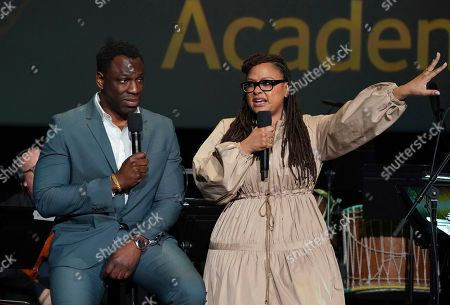 """Hans Charles, Ava DuVernay. Cinematographer Hans Charles, left, and producer/director Ava DuVernay discuss their music choices for the Emmy winning """"13th"""" at the Television Academy member event """"Perfect Harmony: A Live Performance Celebrating the Impact of Music in Documentaries"""" at the Saban Media Center's Wolf Theatre on in North Hollywood, Calif"""