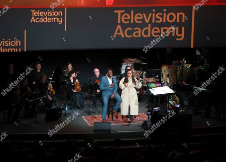 """Stock Picture of Hans Charles, Ava DuVernay. Cinematographer Hans Charles, left, and producer/director Ava DuVernay discuss their music choices for the Emmy winning """"13th"""" at the Television Academy member event """"Perfect Harmony: A Live Performance Celebrating the Impact of Music in Documentaries"""" at the Saban Media Center's Wolf Theatre on in North Hollywood, Calif"""